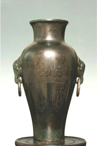 Ming Dynasty Shi Sou bronze and silver inlay vase